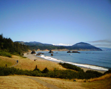 Port-Orford-Battle-Rock-Beach-with-Humbug-Mtn-Off-in-the-Distance